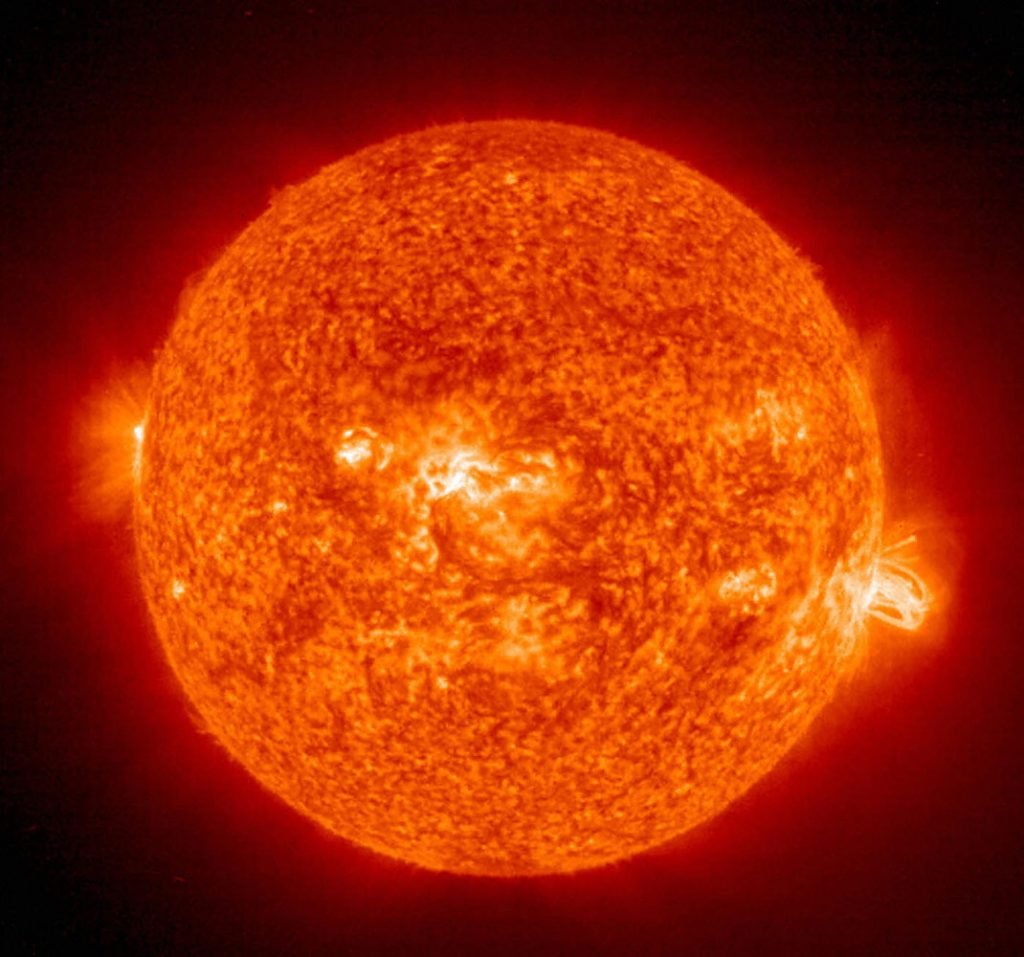 SPACE, SPACE: This 19 August, 2004 NASA Solar and Heliospheric Administration (SOHO) image shows a solar flare(R) erupting from giant sunspot 649. The powerful explosion hurled a coronal mass ejection(CME) into space, but it was directed toward Earth. AFP PHOTO/NASA (Photo credit should read HO/AFP/Getty Images)